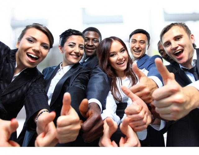 Group of co-workers giving a thumbs up