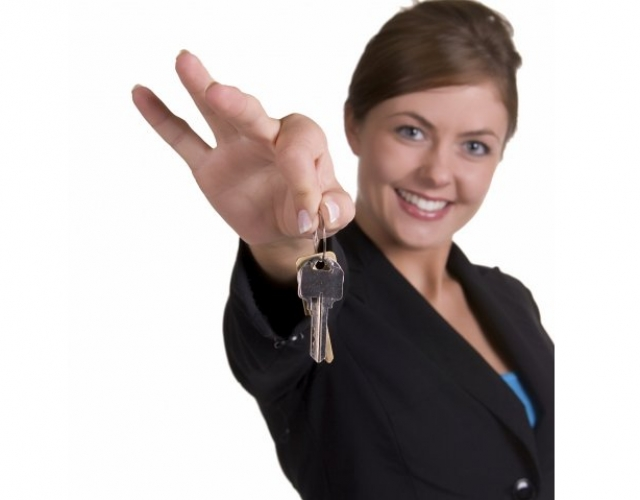 Leasing Consultant Holding Out Keys