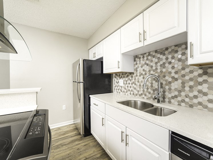 Kitchen With White Cabinetry And Appliances at Lincoln Pointe, Florida
