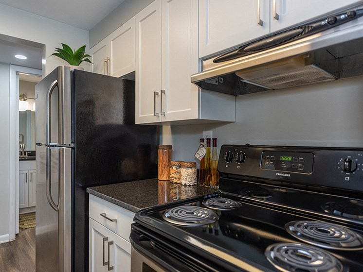 Updated Kitchen With Black Appliances at Ravens Crest Apartments, Manassas, Virginia