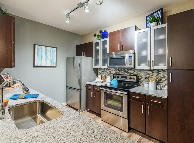 Nona Park Village Apartments - gourmet kitchens with granite countertops