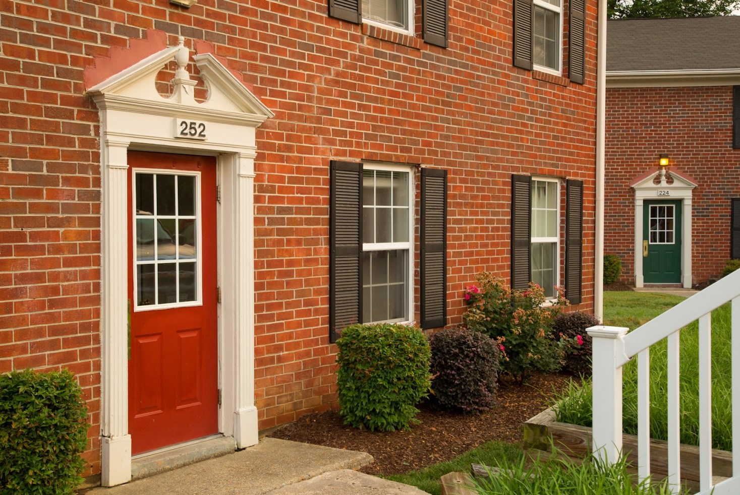 Red door and brick exterior at Colonial Pines Apartments