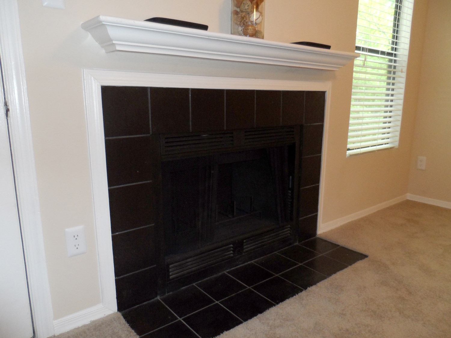 Fireplace at Amberwood at Lochmere Apartments in Cary, NC