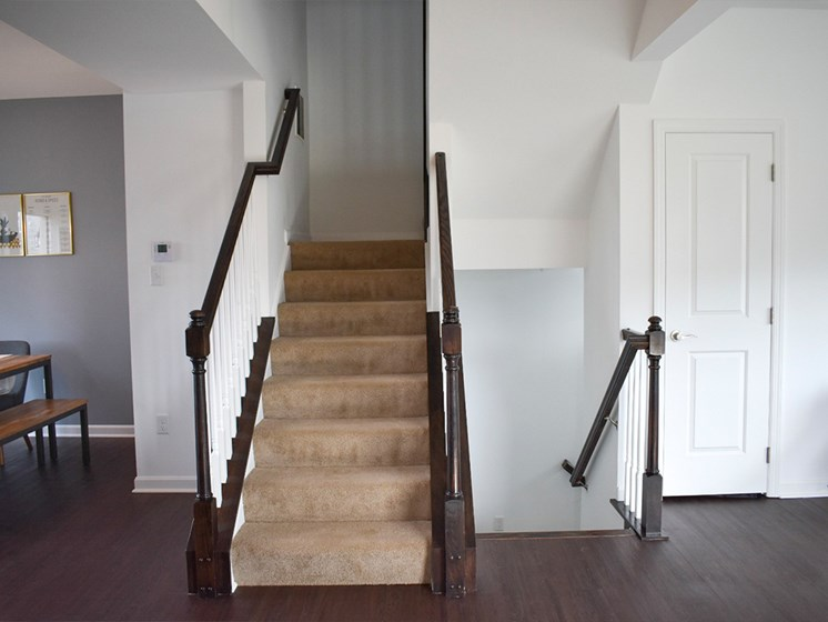 Stairs with espresso banisters, Highland Village Townhomes in North Hills, Pittsburgh, PA 15229