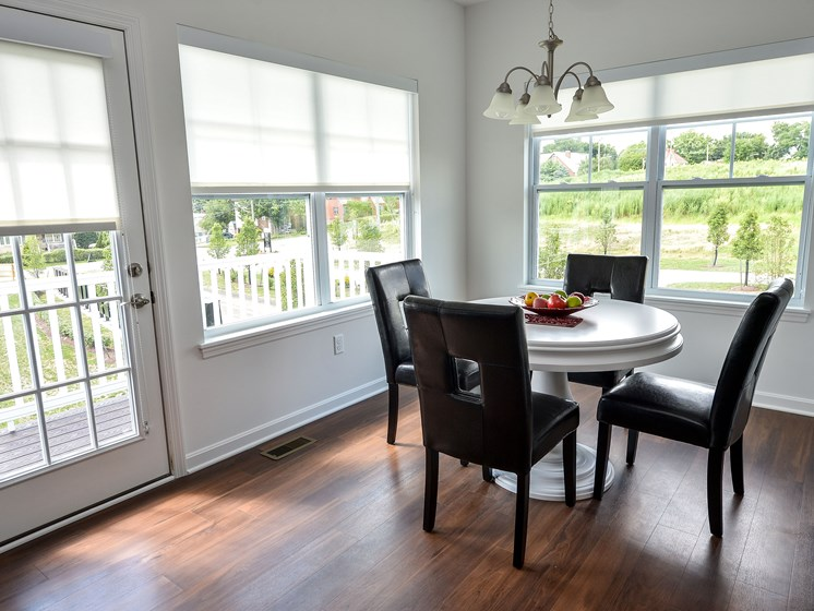 Dining Room with lots of natural light, Highland Village pet-friendly Townhomes in Ross Township, Pittsburgh, PA