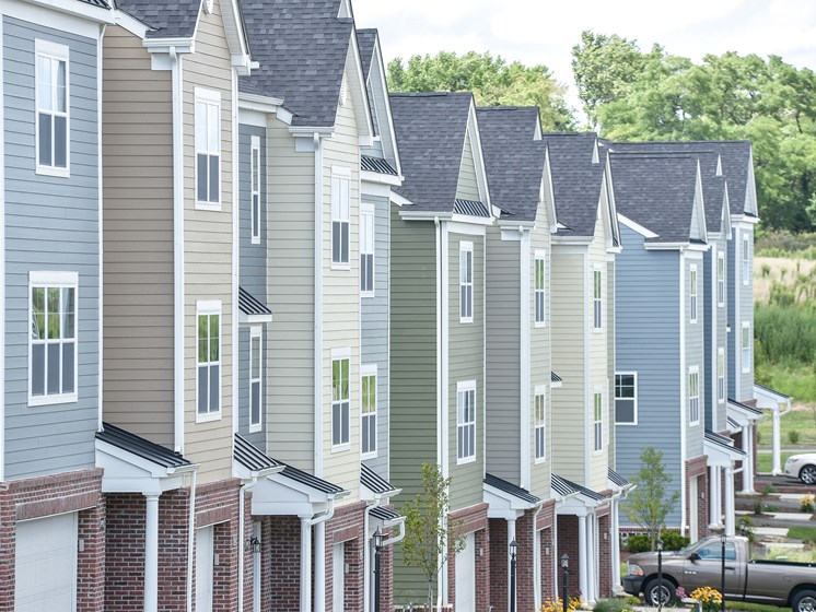 Building exteriors with two car garages, Highland Village Townhomes in Ross Township, Pittsburgh, PA