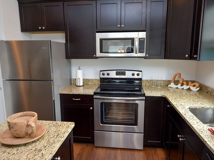 Kitchen with stainless steel appliances, Highland Village pet-friendly Townhomes in Ross Township, Pittsburgh, PA