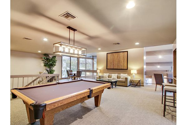 Two-story recreation room with Wi-Fi, at Woodcliff Apartments, 3201 Overland Ave, LA