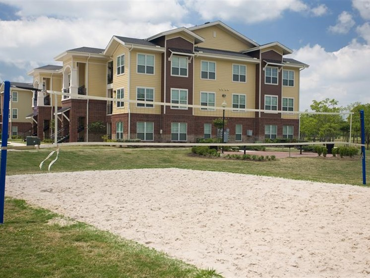 Sand Volleyball Court at Beacon Lakes Apartments, Texas