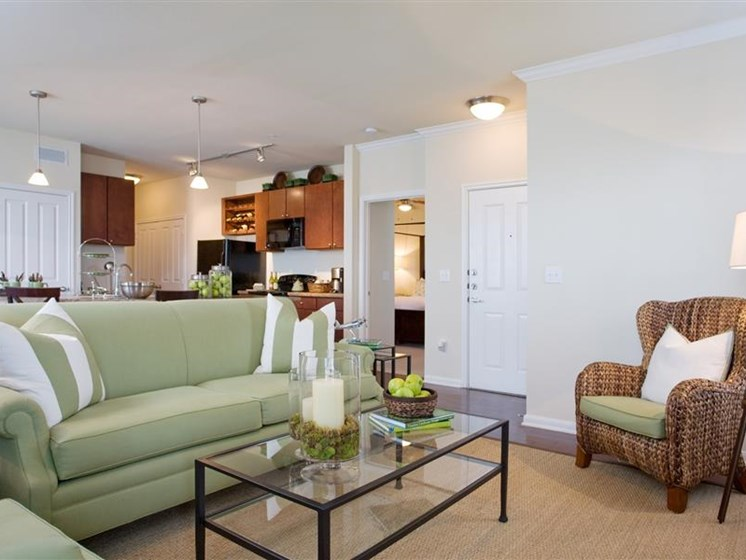 Wall-to-Wall Carpeting in the Living Room at Beacon Lakes Apartments, Dickinson, 77539