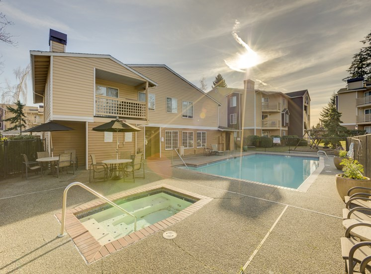 Swimming Pool with Lounge Chairs at Cascadia Pointe,