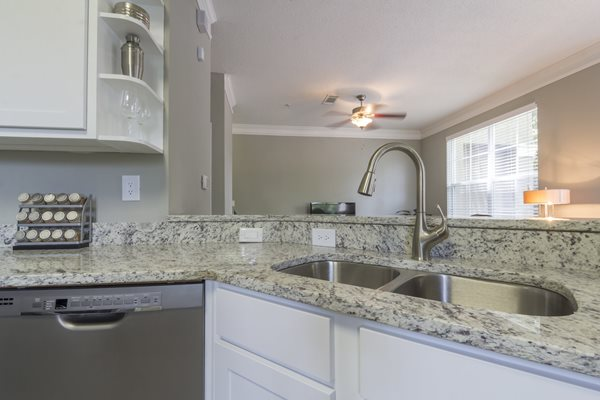 Gourmet Kitchen with Breakfast Bar and Pantry at Deerfield Village Apartments, 13085 Morris Rd, Alpharetta