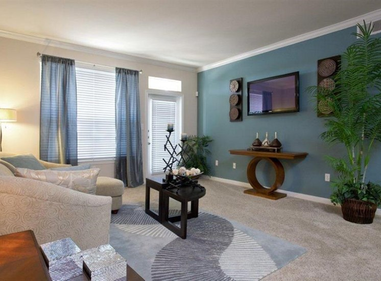 Lush Wall-to-Wall Carpeting in Living Rooms at Estate on Quarry Lake Apartments, TX