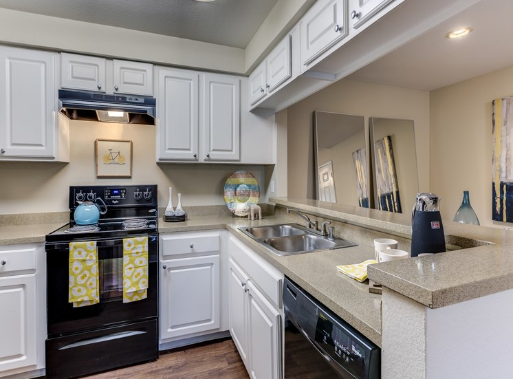 Spacious Kitchen with Pantry Cabinet at Fulton's Crossing Apartments, 98208
