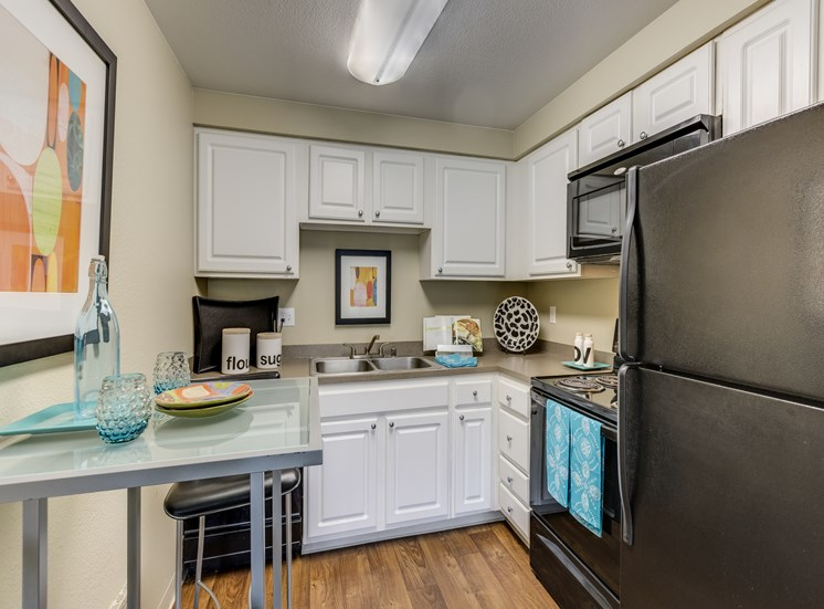 Fully equipped kitchen With Pantry Cabinet at Fulton's Crossing Apartments, 98208