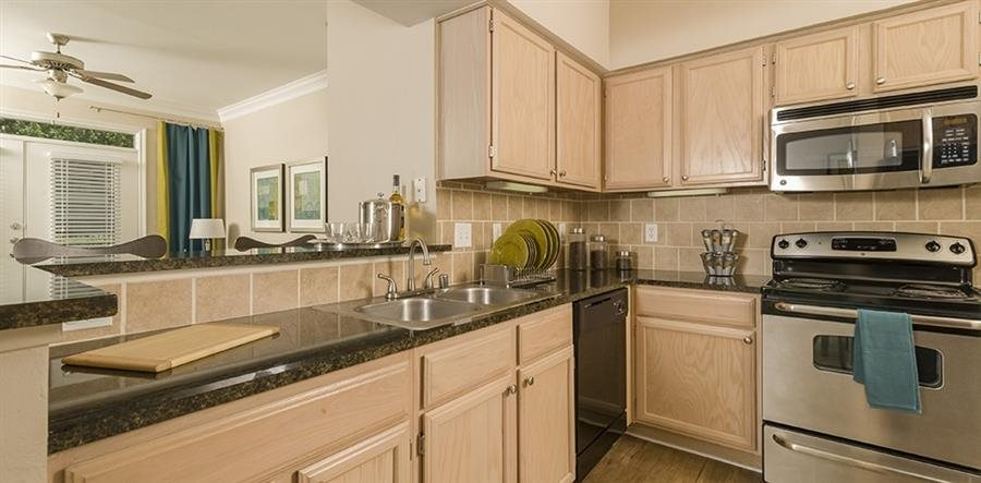 Oak Cabinetry at Kirby Place Apartments, Houston,