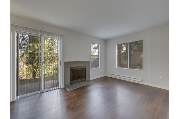 Large Living Room With Fireplace and Over sized Windows at Nickel Creek Apartments, 3702 204th St SW, 98036