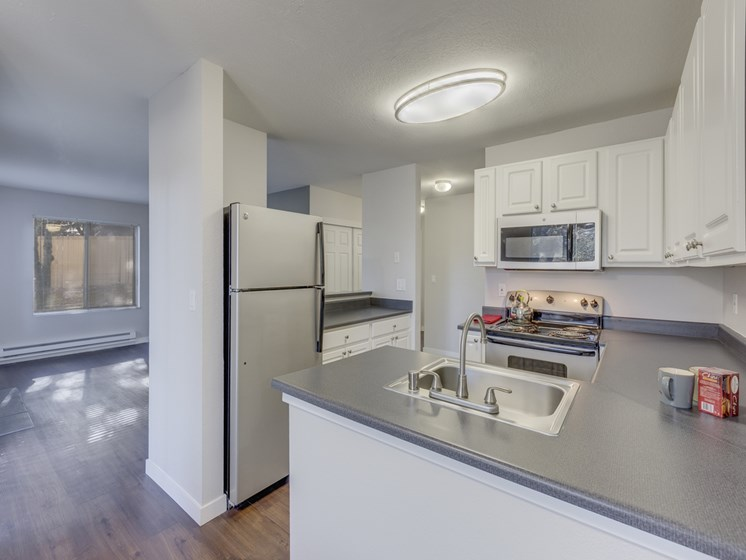 Gourmet Kitchens with Dishwasher and Disposal at Nickel Creek Apartments, 3702 204th St SW, 98036