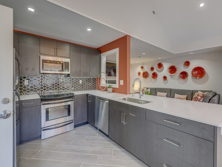 Gourmet Kitchens with Islands, Caesarstone Countertops, and Decorative Backsplash at Nickel Creek Apartments, 3702 204th St SW, 98036