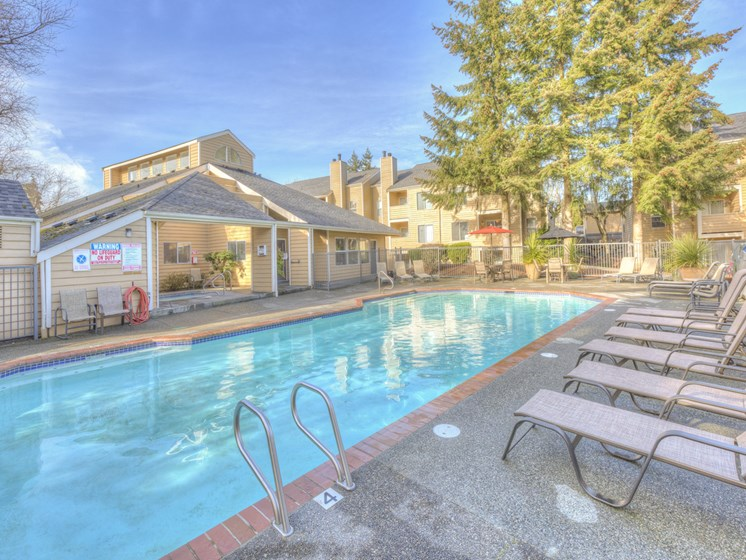 Sparkling Pool And Pool side Relaxing Area at Nickel Creek Apartments, WA 98036