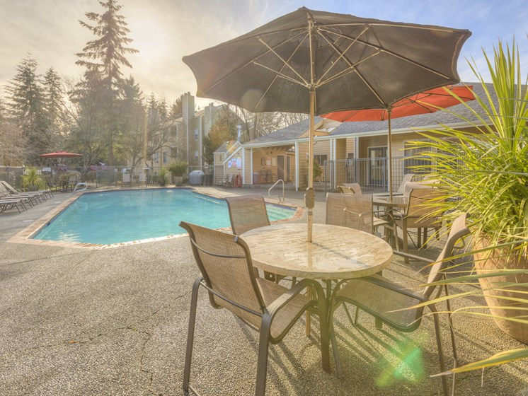 Outdoor Lounge Area at Nickel Creek Apartments, 3702 204th St SW, Lynnwood, 98036