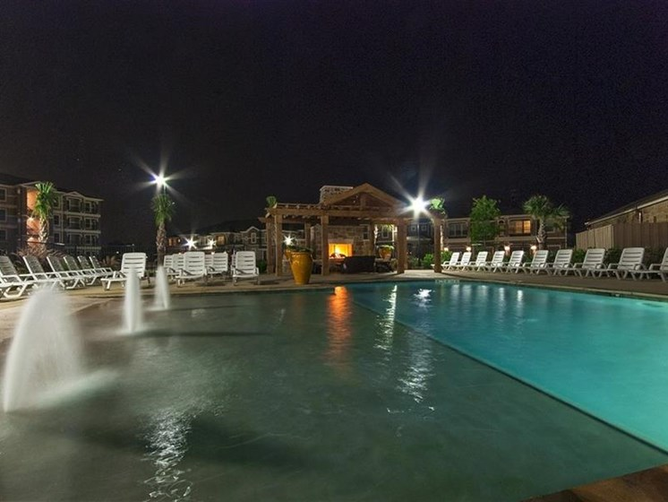 Night View Resort-style Pool With Sundeck at Parc Woodland, Texas