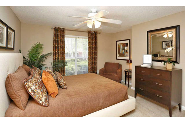 Spacious Bedroom With Ceiling Fans at Roswell Village Apartments,