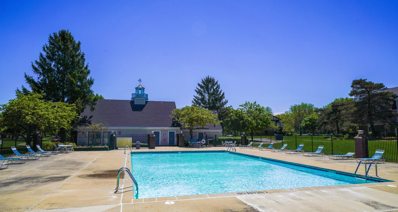 Blue Cool Swimming Pool at Walnut Trail Apartments, Portage