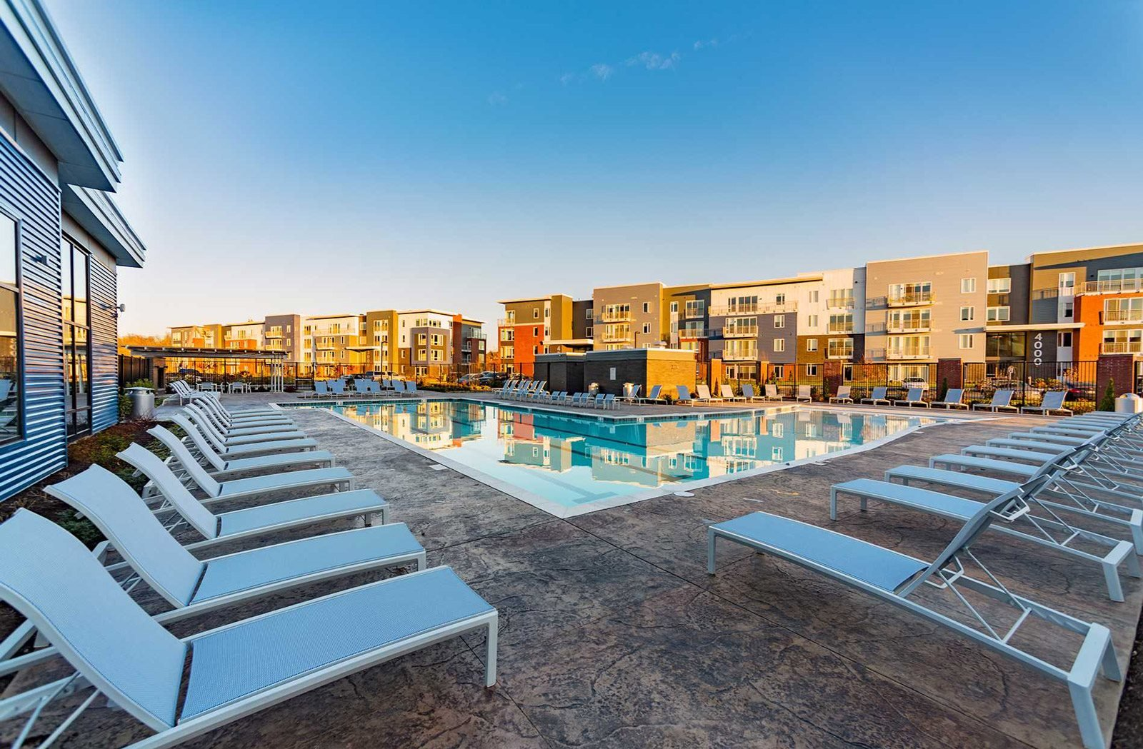 The Ridge at Robinson Apartments Offers Pool Side Relaxing Area With Easy Chairs