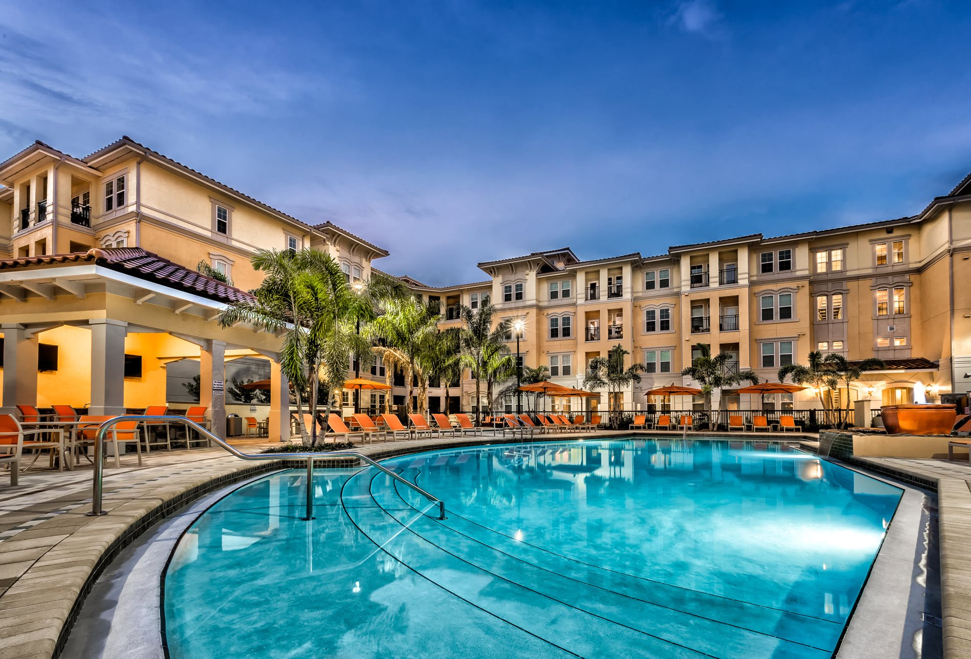 Lounging by the Pool at  Lugano Apartments, Kissimmee