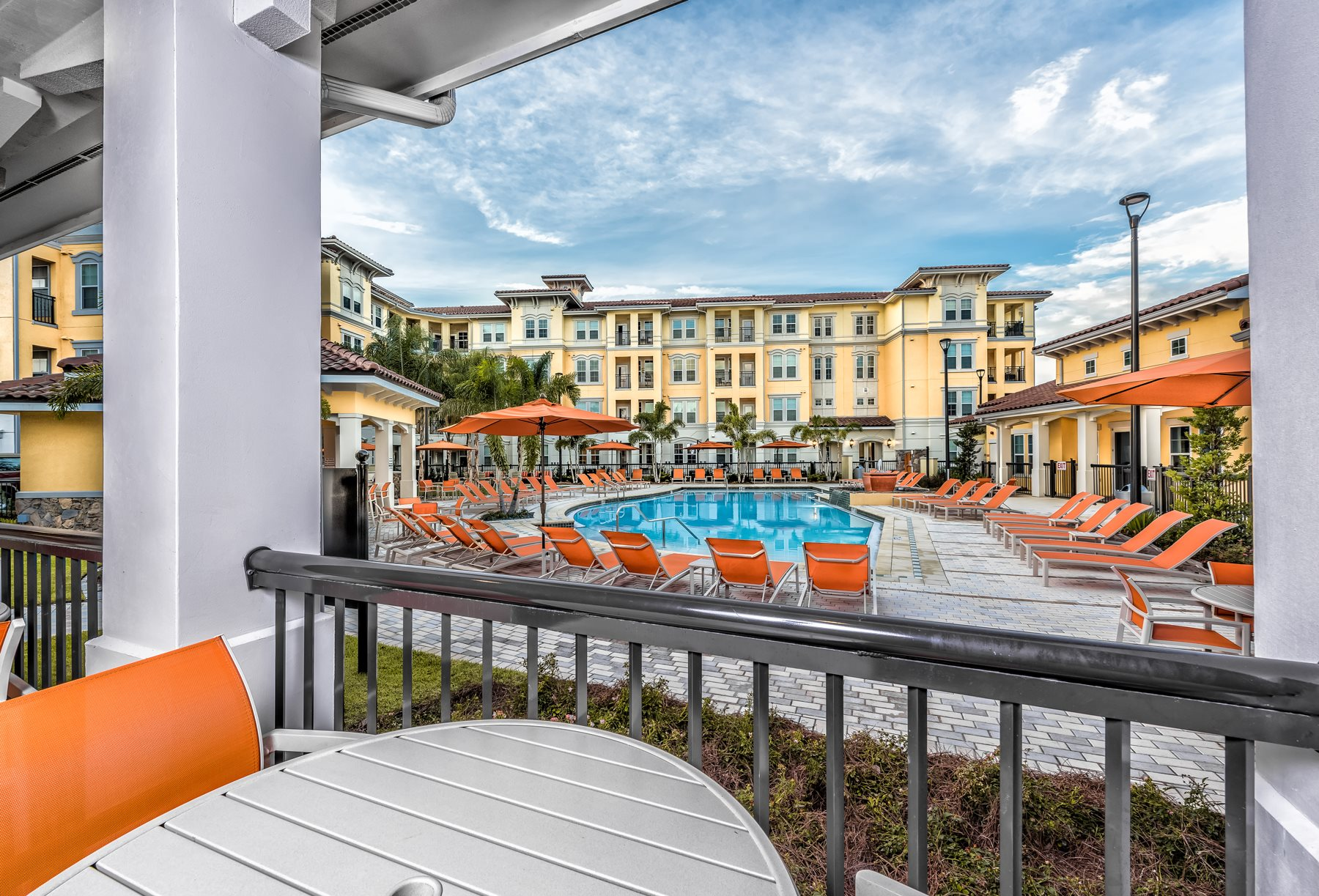 Outdoor Dining Area with Pool View at  Lugano Apartments, Kissimmee Florida