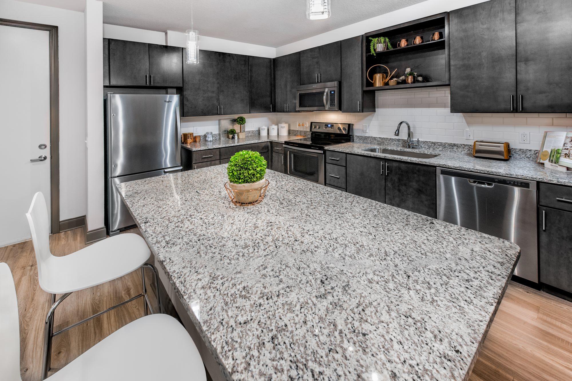 Granite Countertops in Kitchen at  Lugano Apartments, Kissimmee, FL 34741