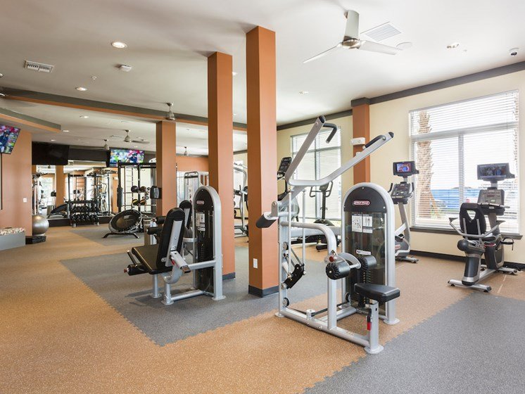 Landon House Apartments in Lake Nona Orlando, FL 32827 fitness center with weight equipment