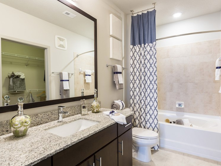 Landon House Apartments in Lake Nona Orlando, FL 32827 bathrooms with tile and granite