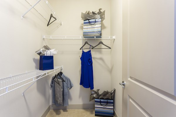 large closet with built-in wire shelving