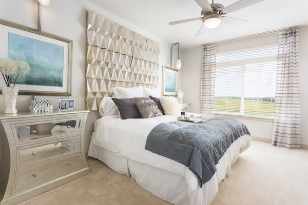 large bedroom with ceiling fan light kit and plush carpet