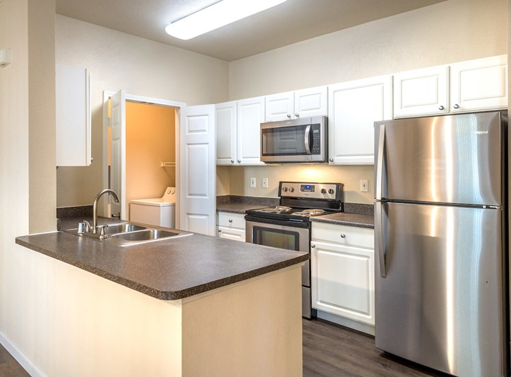 Kitchen showing stainless steel appliances