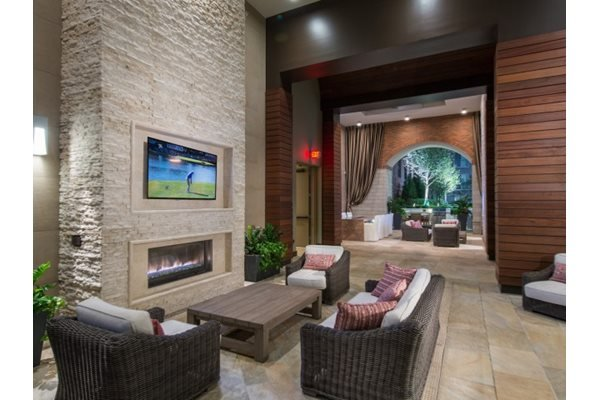 Open-Air Loggia With Fireplace and HDTV Lounge at Windsor at Cambridge Park, 160 Cambridge Park Drive, Cambridge, MA 2140