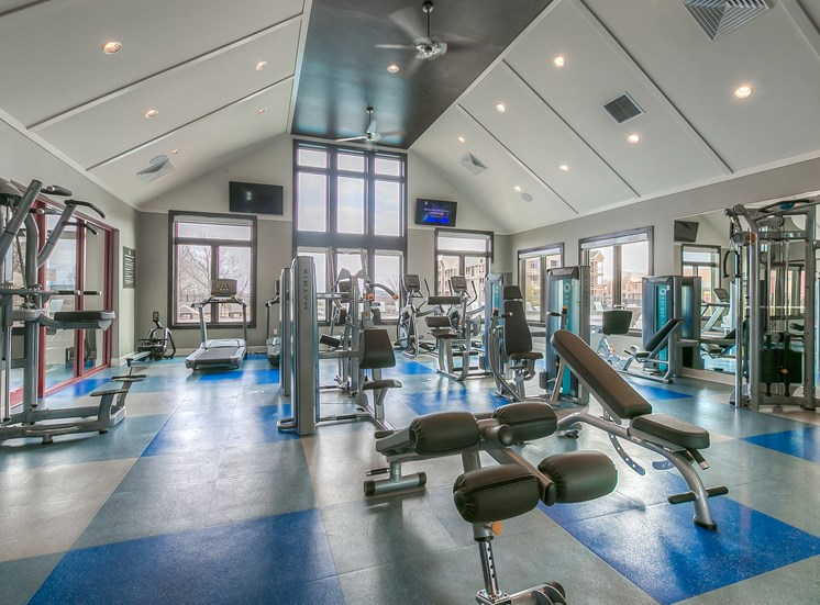 Lenexa Apartments for Rent-Waterside Residences at Quivira Apartments Spacious Gym With Updated Machines And Views Of Property