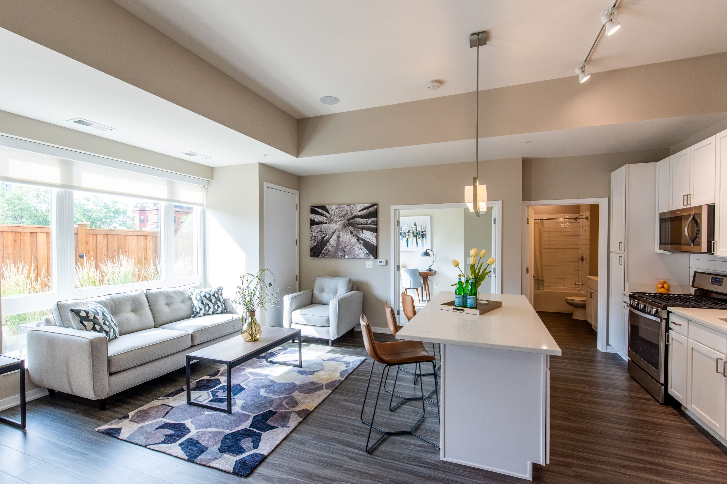 Spacious living room and kitchen with natural lighting