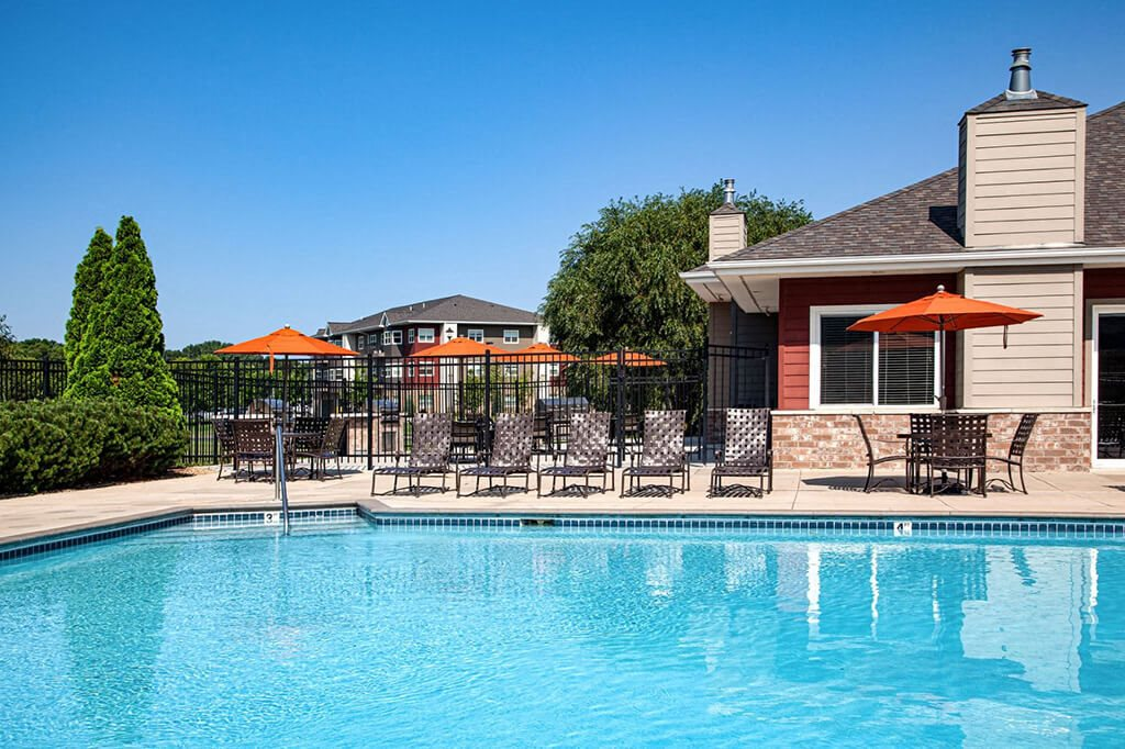 Outdoor pool with attached clubhouse