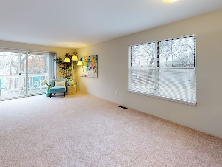 Spacious Living Rooms at The Bronco Club Townhomes in Kalamazoo, MI near Western Michigan University