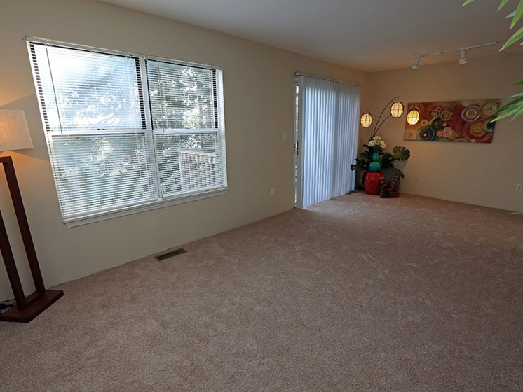 Spacious Living Room At The Bronco Club Townhomes In Kalamazoo, MI Near Western Michigan University