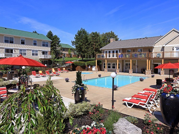 Serene Pool and Lounging Area  At The Bronco Club Townhomes In Kalamazoo, MI Near Western Michigan University