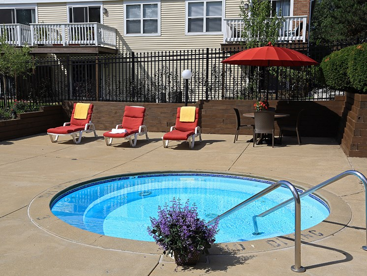 Tranquil Hot Tub At The Bronco Club Townhomes In Kalamazoo, MI Near Western Michigan University