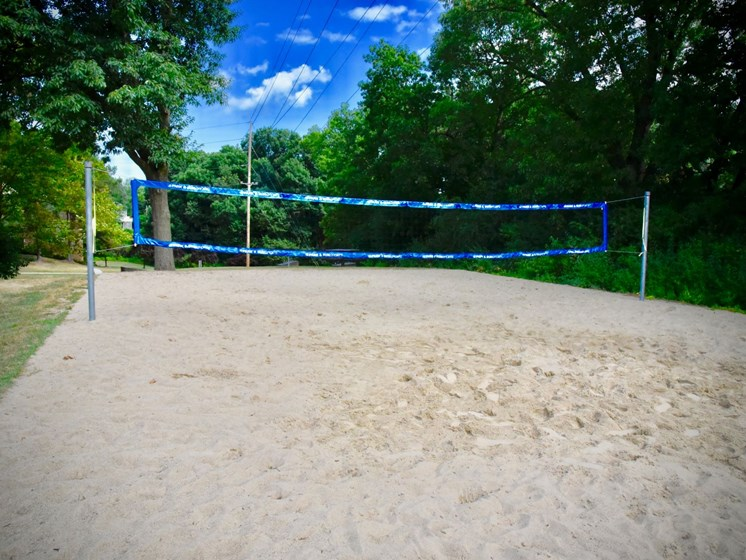 Sand Volleyball at The Bronco Club Townhomes  in Kalamazoo, MI near Western Michigan University