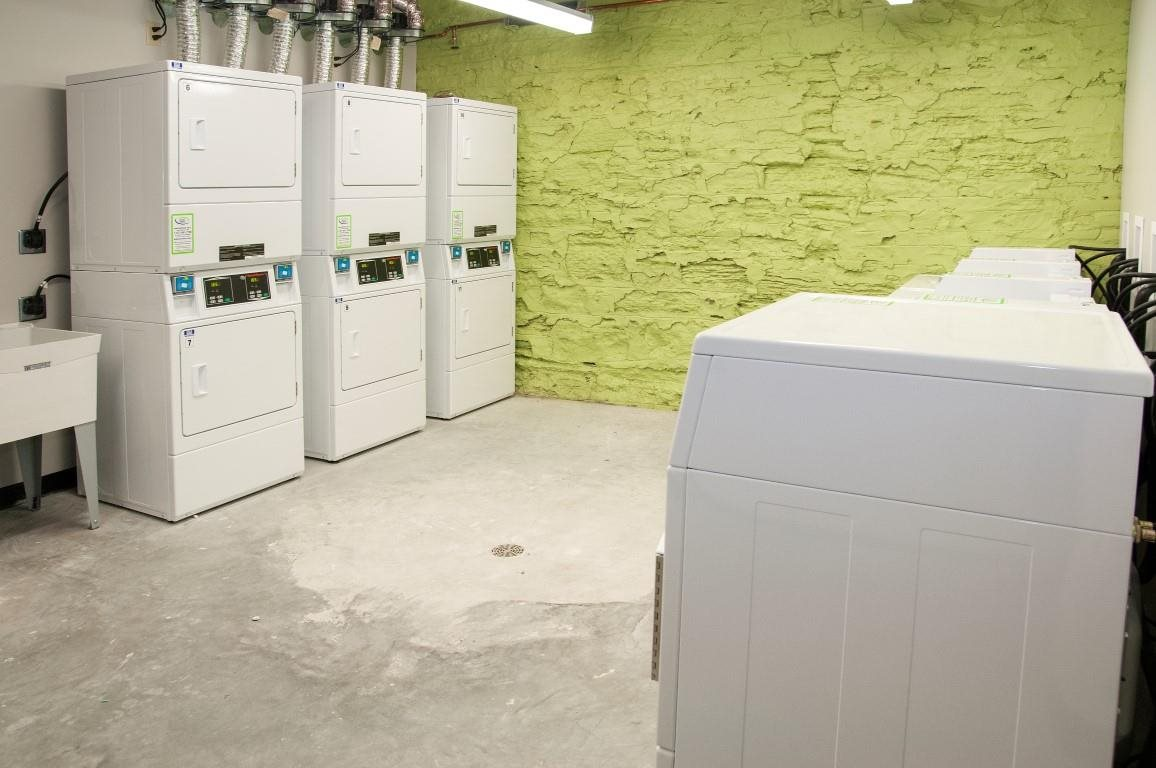 Drying Machines in Laundry Room of The Cameron North Loop