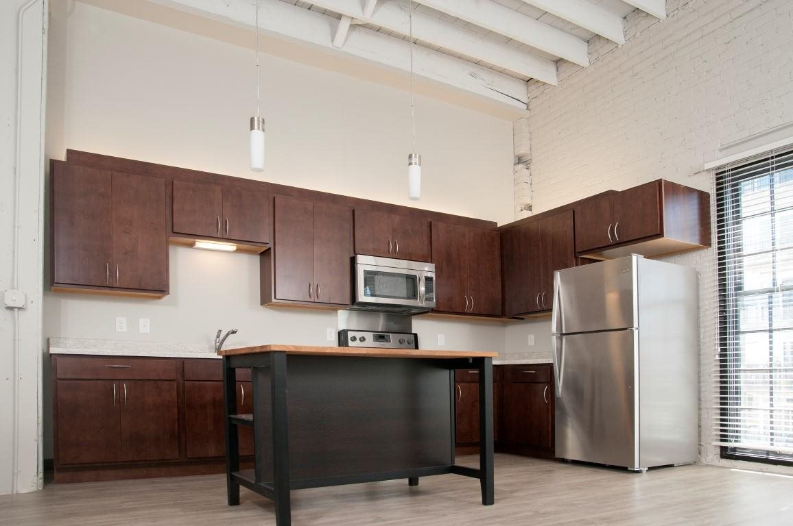Kitchen with High Ceilings and New Appliances at Apartment in North Loop