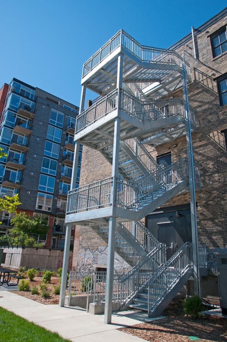 The Cameron Side Exterior with Fire Escape Stairwell