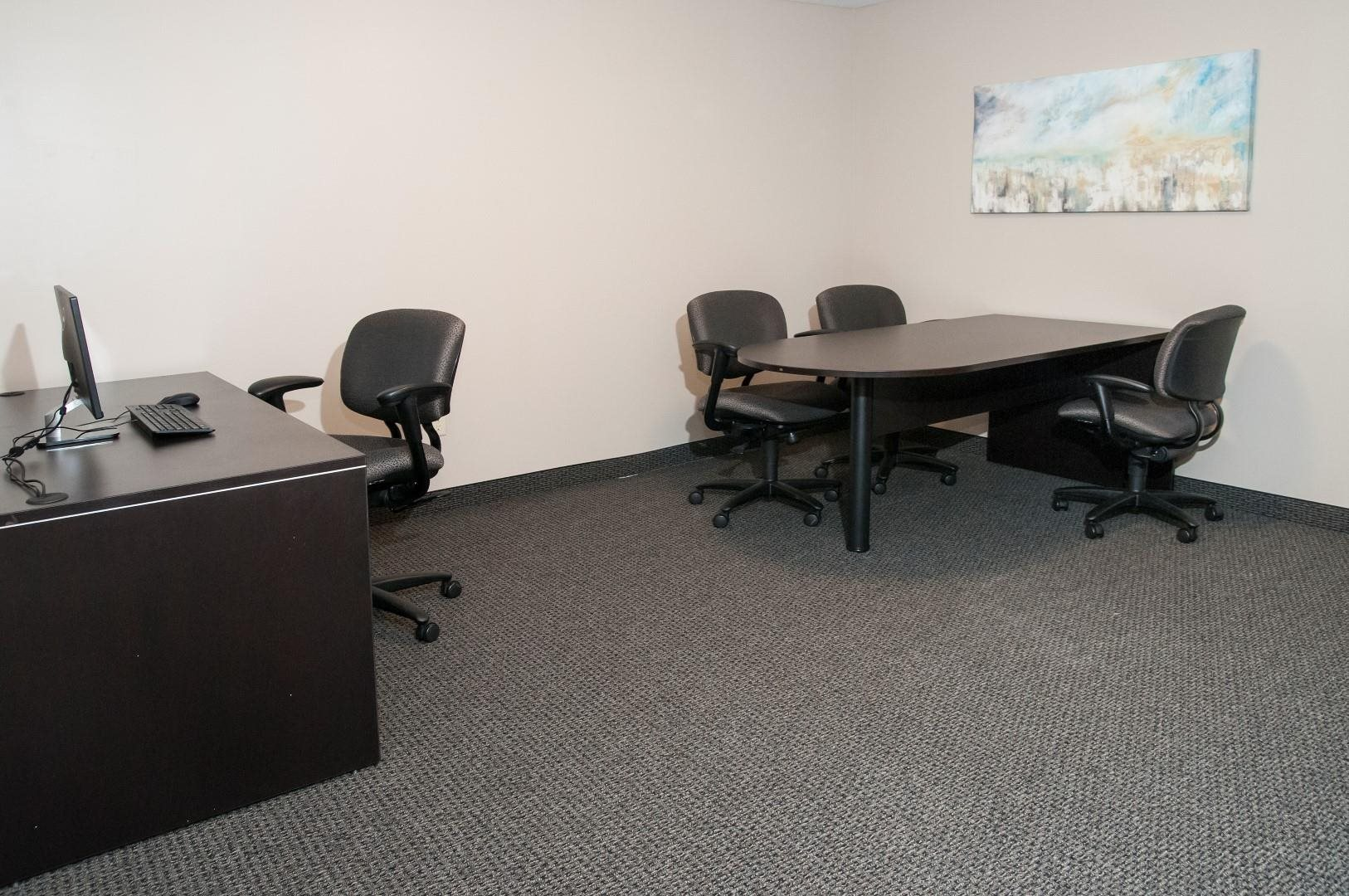 Office Space with Office Chairs, Work Tables and Computers at Compass Pointe in New Hope, MN